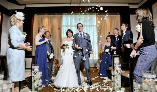 mandalay-bay-weddings-chapel-lifestyle-bride-and-groom-walking-down-the-aisle.tif.image.550.325.high
